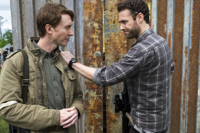 <p>Ross Marquand as Aaron and Jordan Woods-Robinson as Eric in AMC's <i>The Walking Dead</i>.<br>(Photo: Gene Page/AMC) </p>