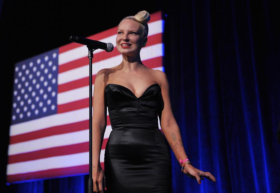 Australian singer and songwriter Sia smiles as she finishes her performance at the Democratic National Committee LGBT Gala at Gotham Hall on June 17, 2014 in New York, New York. AFP PHOTO/Mandel NGAN        (Photo credit should read MANDEL NGAN/AFP via Getty Images)