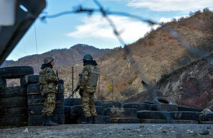 Armenian soldiers set up checkpoints on the road leading to Kalbajar