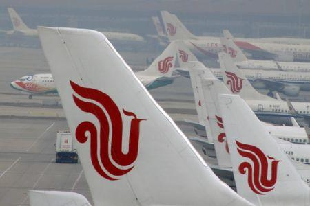FILE PHOTO -  Flights of Air China are parked on the tarmac of Beijing Capital International Airport in Beijing, China, March 28, 2016. REUTERS/Kim Kyung-Hoon/File Photo