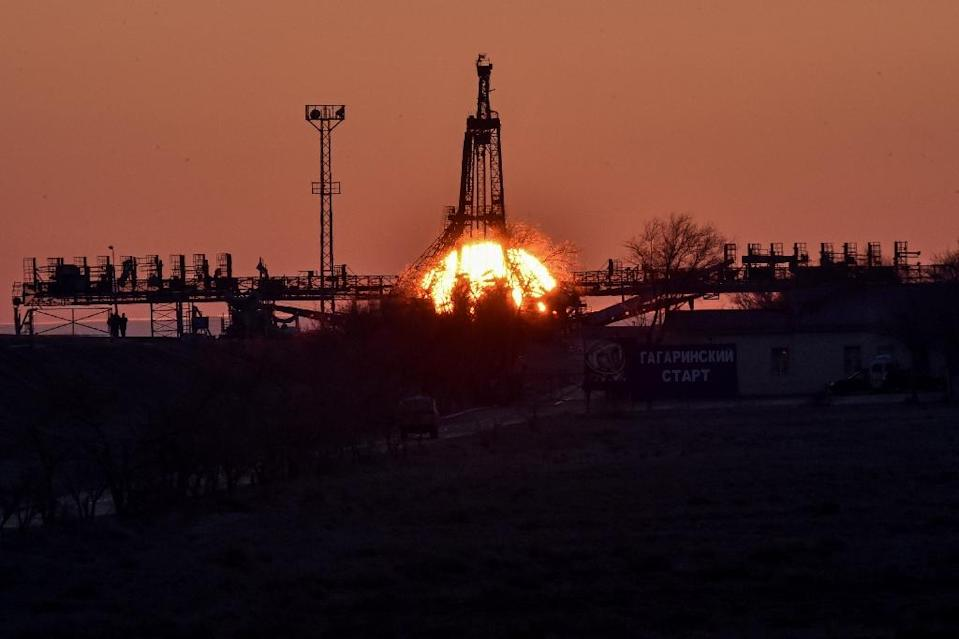 The sun rises over a launch pad at the Russian-leased Baikonur cosmodrome in Kazakhstan, on March 25, 2015 (AFP Photo/Kirill Kudryavtsev)