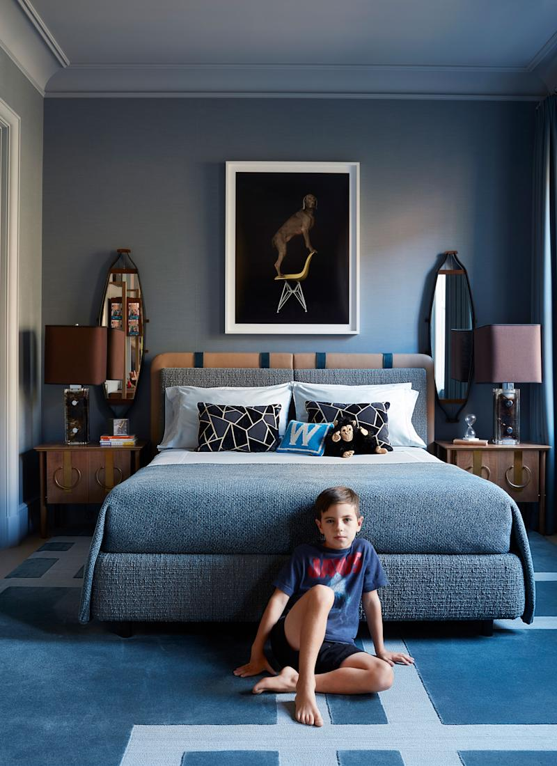 Willem sits on the custom stark rug in his bedroom; vintage mirrors, lamps, and side tables. Photo by William Wegman.