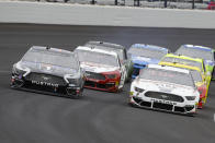 Kevin Harvick, left, and Brad Keselowski, right, drive through the first turn during the NASCAR Brickyard 400 auto race at Indianapolis Motor Speedway, Sunday, Sept. 8, 2019, in Indianapolis. (AP Photo/Darron Cummings)