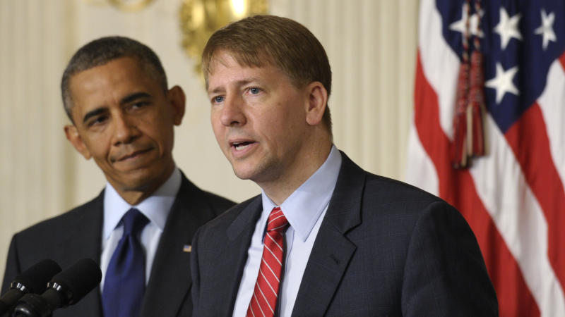 President Barack Obama, left, listens as Richard Cordray, right, the new director of the Consumer Financial Protection Bureau, speaks in the State Dining Room of the White House in Washington, Wednesday, July 17, 2013. The Senate voted on Tuesday, July 16, 2013, to end a two-year Republican blockade that was preventing Cordray from winning confirmation as director of the Consumer Financial Protection Bureau. (AP Photo/Susan Walsh)