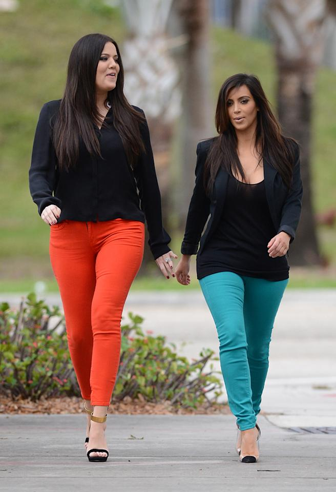 "December 15, 2012: Kim Kardashian and Khloe Kardashian sporting bright complementary colored skinny jeans, go for a walk at the MacArthur Causeway--the sight of the Miami cannibal attack dubbed ""Causeway Cannibal""--in Miami, Florida.