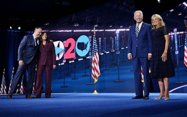 PHOTO: Democratic vice presidential nominee Sen. Kamala Harris and her husband Douglas Emhoff stand on stage with Democratic presidential candidate Joe Biden and his wife Dr. Jill Biden during the Democratic National Convention, Aug. 19, 2020. (AFP via Getty Images)