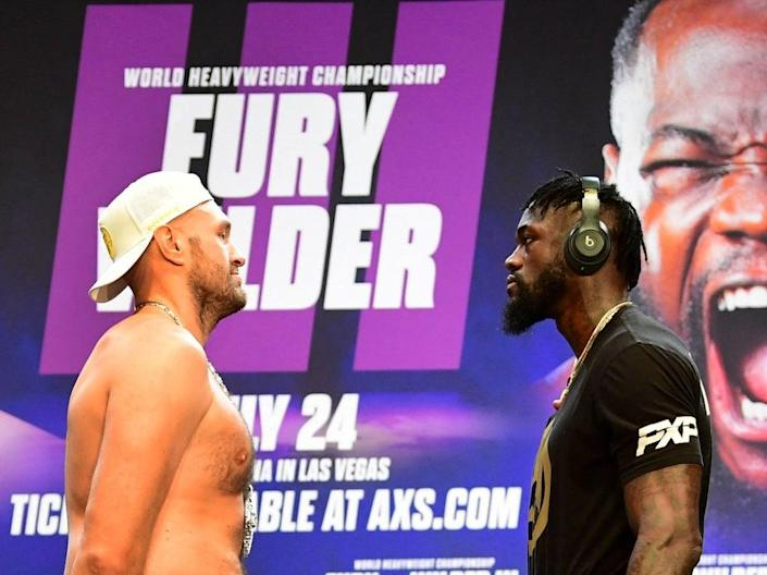 Tyson Fury (left) and Deontay Wilder face off ahead of their trilogy fight (AFP via Getty Images)