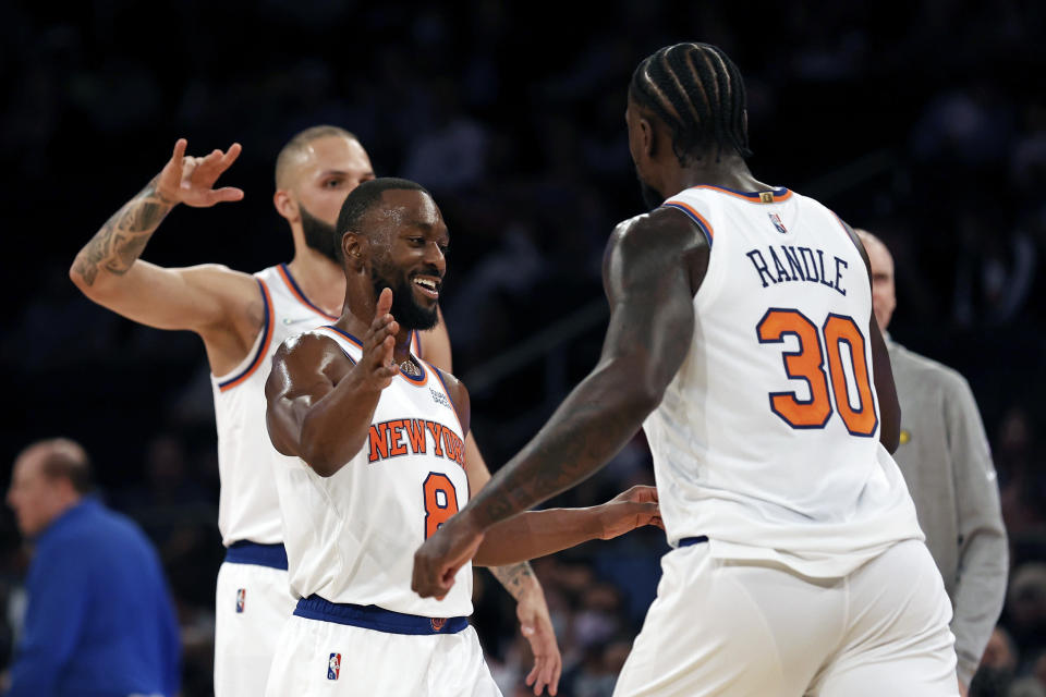 New York Knicks guard Kemba Walker (8) celebrates with forward Julius Randle (30) against the Indiana Pacers during the first half of a preseason NBA basketball game Tuesday, Oct. 5, 2021, in New York. The Knicks won 125-104. (AP Photo/Adam Hunger)