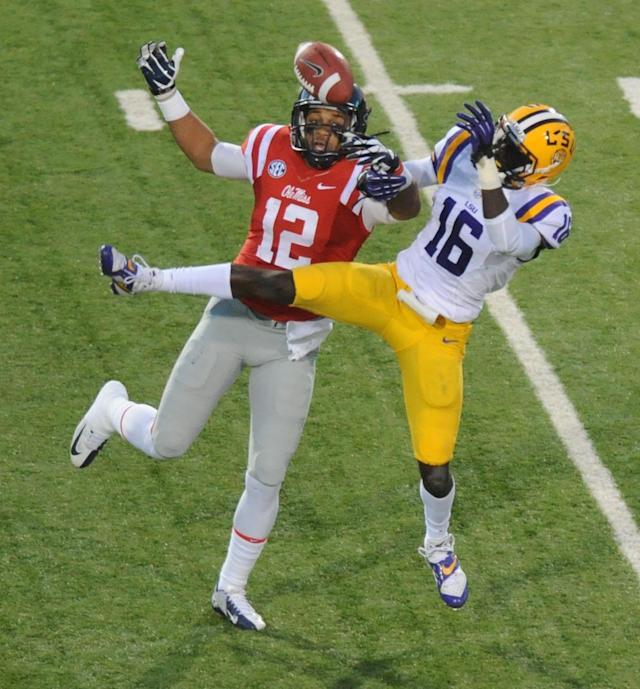 Mississippi wide receiver Donte Moncrief (12) attempts to catch a pass as LSU's Tre'Davious White (16) defends during an NCAA college football game in Oxford, Miss., Saturday, Oct. 19, 2013. (AP Photo/The Oxford Eagle, Bruce Newman)