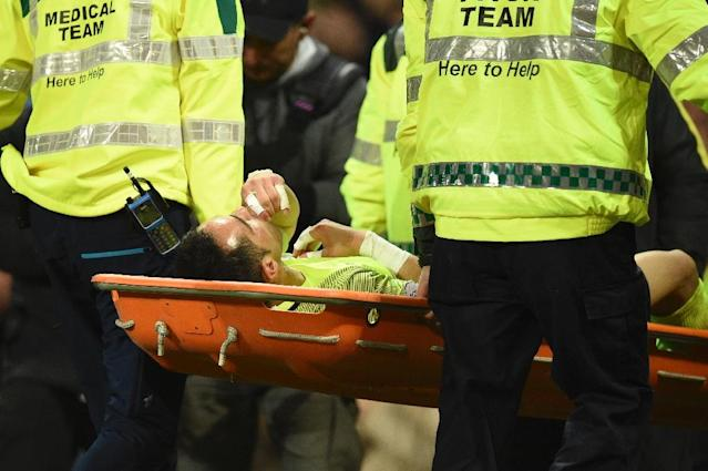 Members of the pitch medical team carry off Manchester City's goalkeeper Claudio Bravo on a stretcher after he got injured during the English Premier League football match April 27, 2017 (AFP Photo/Oli SCARFF )