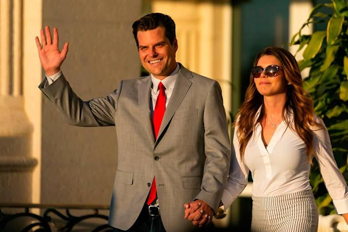 """U.S. Representative Matt Gaetz and his fiance Ginger Luckey arrive to the """"Save America Summit"""" at the Trump National Doral Resort in Doral on Friday, April 9, 2021."""