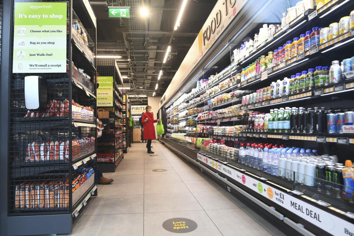 The Amazon Fresh grocery store opens to the public in London, Thursday March 4, 2021, where shoppers will be able to pick up items and walk out of the store, contactless, without the need for a till. Customers will scan a QR code on their way into the store, with cameras and technology identifying the items that shoppers take from the shelves and their account automatically paid. (Victoria Jones/PA via AP)