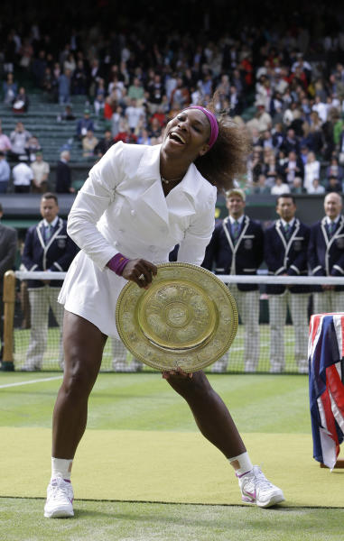 Serena Williams of the United States poses with her trophy after defeating Agnieszka Radwanska of Poland to win the women's final match at the All England Lawn Tennis Championships at Wimbledon, England, Saturday, July 7, 2012. (AP Photo/Kirsty Wigglesworth)