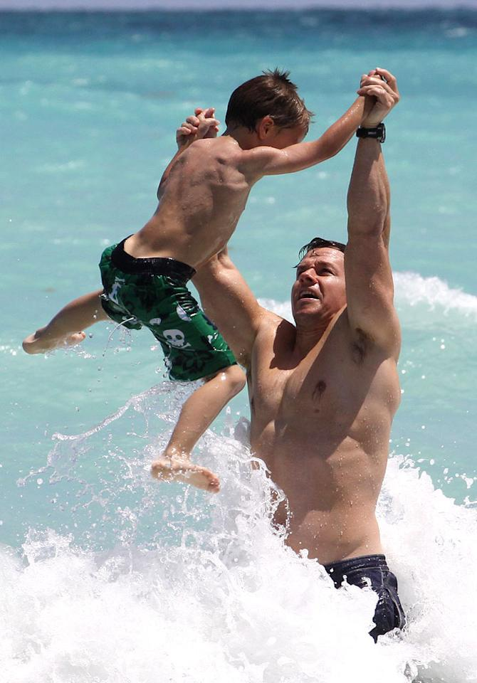 """<p>Mark and his eldest son Michael ventured out to deeper waters to ride the waves. It looks likes the 6-year-old could have a future as an action hero <span style=""""font-size:12.0pt;"""">— </span>just like his dad. (4/8/2012)</p>"""