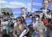FILE - In this July 4, 2020, file photo, supporters hold banners of Presidential Candidate and Warsaw Mayor Rafal Trzaskowski during a rally in Czestochowa, Poland. Trzaskowski and President Andrzej Duda are heading into a tight presidential runoff that is seen as an important test for populism in Europe. The Sunday, July 12 election comes after a bitter campaign that has exacerbated a conservative-liberal divide in the country. (AP Photo/Czarek Sokolowski, File)