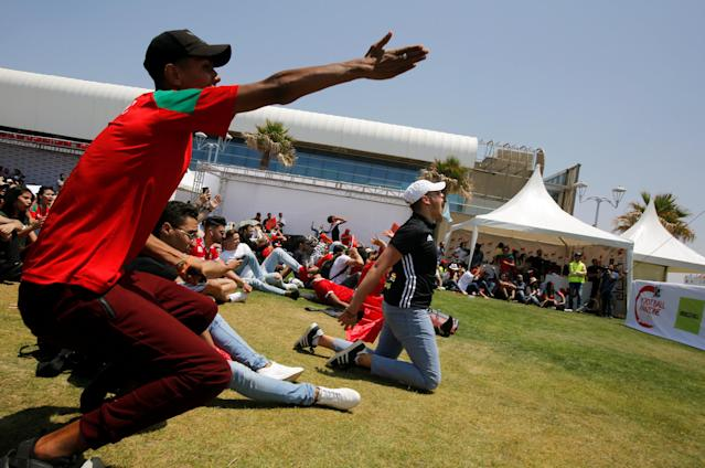 Soccer Football - World Cup - Group B - Portugal vs Morocco - Casablanca, Morocco - June 20, 2018. Fans react as they watch the match during a public screening in Casablanca. REUTERS/Youssef Boudlal