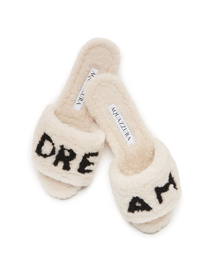 """<p><em>Aquazzura Relax Slides, $995</em></p><p><a class=""""link rapid-noclick-resp"""" href=""""https://www.amazon.com/dp/B092GJJ1HC/ref=cm_sw_r_cp_api_glt_fabc_N6VQYBT2BX80VX31V226?tag=syn-yahoo-20&ascsubtag=%5Bartid%7C10056.g.36320745%5Bsrc%7Cyahoo-us"""" rel=""""nofollow noopener"""" target=""""_blank"""" data-ylk=""""slk:SHOP NOW"""">SHOP NOW</a></p><p>Edgardo Osorio's designs run the gamut from casual and easy to formal. For Andelman's red-carpet-at-home edit, these plush slides are a perfect fit.</p>"""