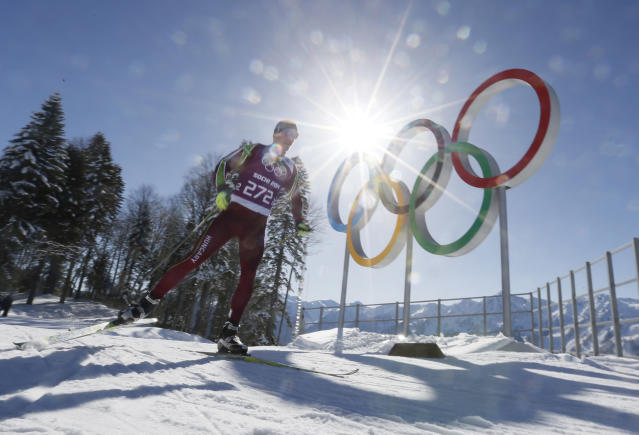 Hungary's Milan Szabo passes by Olympic rings as he trains in the Cross Country stadium of the 2014 Winter Olympics, Tuesday, Feb. 4, 2014, in Krasnaya Polyana, Russia. (AP Photo/Dmitry Lovetsky)