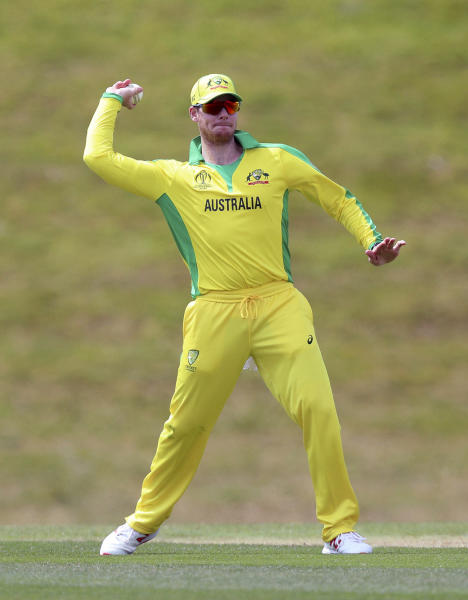 Australia's Steve Smith prepares to throw the ball during the World Cup warm-up match at the Nursery Ground, Southampton. (Andrew Matthews/PA via AP)