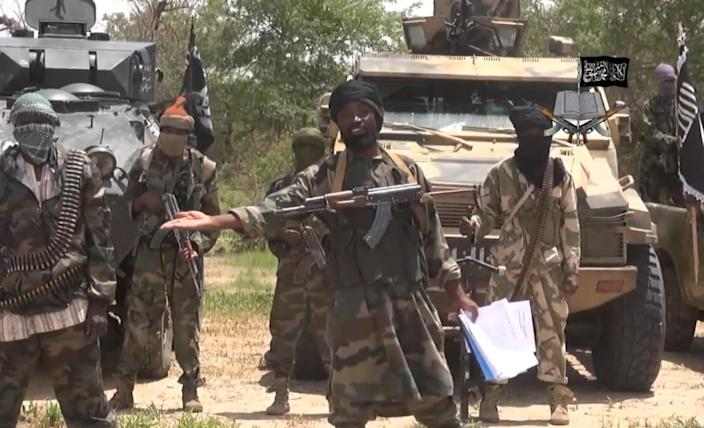 A video released by Boko Haram on July 13, 2014 purports to show Abubakar Shekau flanked by armed militants (AFP Photo/)