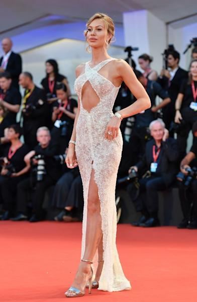 Influencer Taylor Mega turned up the heat at the Lido in a sensual, slightly sheer cut-out dress by João Rôlo Couture. Venice, September 2, 2019