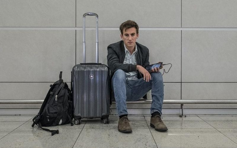 Our man Raf at the airport with his electronics. But did he manage to board with them in his carry-on luggage? - Alexandra Howland