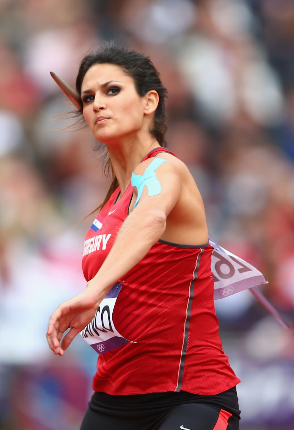 """<a href=""""http://sports.yahoo.com/olympics/track-field/leryn-franco-1086669/"""" data-ylk=""""slk:Leryn Franco"""" class=""""link rapid-noclick-resp"""">Leryn Franco</a> of Paraguay competes in the Women's Javelin Throw Qualification on Day 11 of the London 2012 Olympic Games. Franco finished 18th in the qualifying round with a throw of 51.45m and failed to make it to the final. (Photo by Michael Steele/Getty Images)"""
