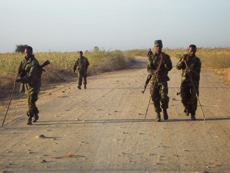 Ethiopian soldiers check for landmines on a road leading to the eastern Ethiopian-Eritrean border town of Badme