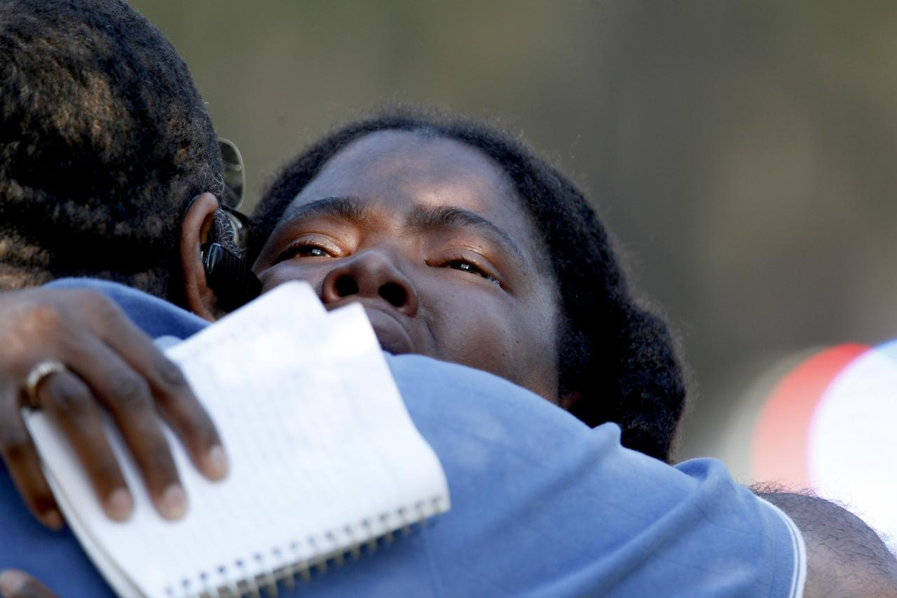 THE WOODLANDS, TX - JANUARY 22:  Lone Star College Freshman Sheketa Taylor hugs her father Judson Gimblin after they found each other on the Lone Star Campus on January 22, 2013 in The Woodlands, Texas. According to reports, three people were injured during a shooting on the courtyard between the Library and cafeteria.  (Photo by Thomas B. Shea/Getty Images)