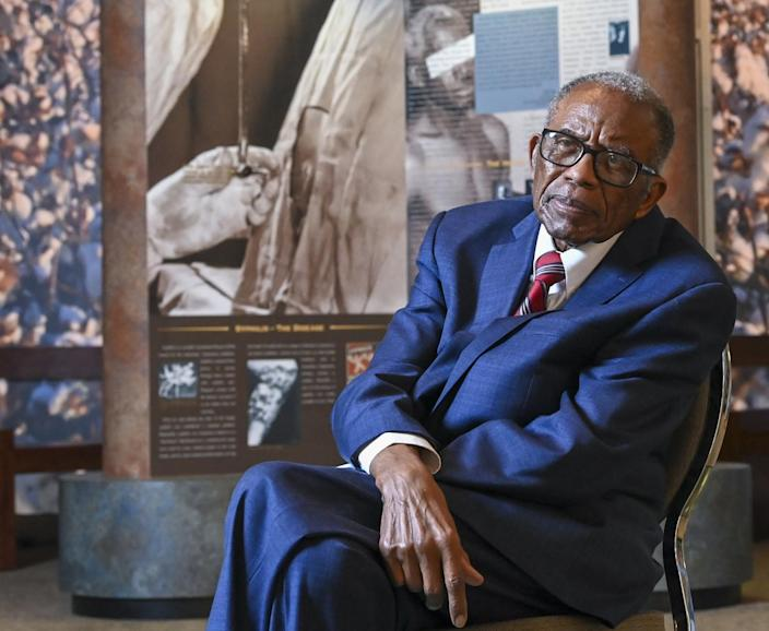 Civil rights attorney Fred Gray seated at a museum.