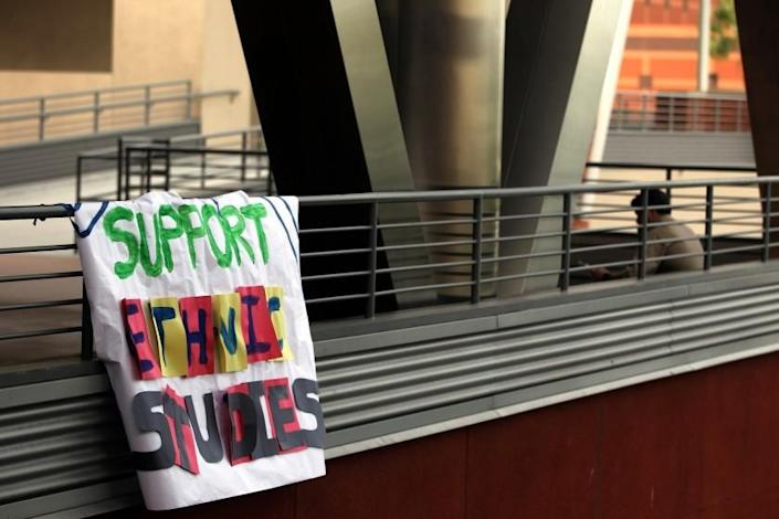 """A banner hangs from an upper-floor railing as students demonstrate at Cal State L.A. in 2014 in support of ethnic studies courses. <span class=""""copyright"""">(Los Angeles Times)</span>"""