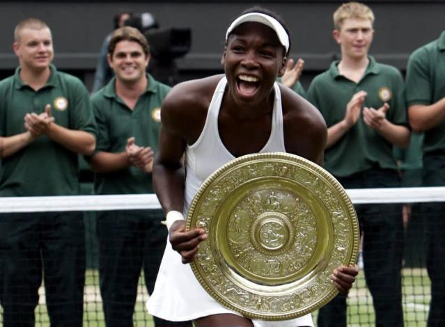 FILE PHOTO: Venus Williams of the U.S. celebrates with the Rosewater Dish after winning the 2005 Wimbledon title