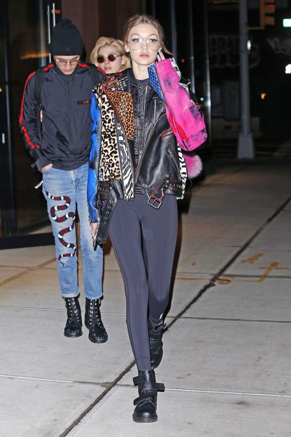 <p>In a Marc Jacobs printed motorcycle jacket, leggings, wire-rim glasses and Dr. Martens boots while out in New York</p>