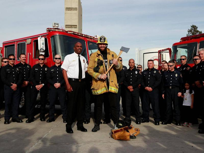 Fury presented tickets to a group of LA firefighters (Action Images via Reuters)