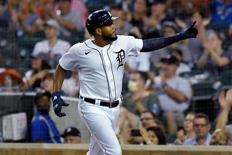 Detroit Tigers' Jeimer Candelario points to the crowd after scoring against the Toronto Blue Jays during the fourth inning of a baseball game Friday, Aug. 27, 2021, in Detroit.