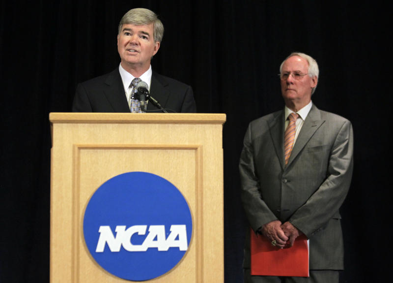 NCAA President Mark Emmert, left, announces penalties against Penn State as Ed Ray, NCAA Executive Committee chair and Oregon State University president, looks on at right, during a news conference in Indianapolis, Monday, July 23, 2012. The NCAA has slammed Penn State with an unprecedented series of penalties, including a $60 million fine and the loss of all coach Joe Paterno's victories from 1998-2011, in the wake of the Jerry Sandusky child sex abuse scandal. (AP Photo/Michael Conroy)