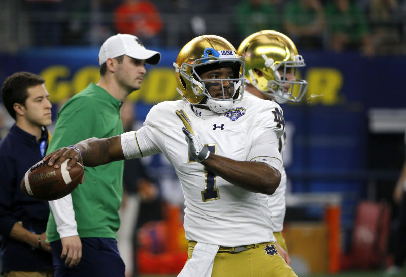Notre Dame quarterback Brandon Wimbush (7) warms up before the NCAA Cotton Bowl semi-final playoff football game against Clemson on Saturday, Dec. 29, 2018, in Arlington, Texas. (AP Photo/Michael Ainsworth)