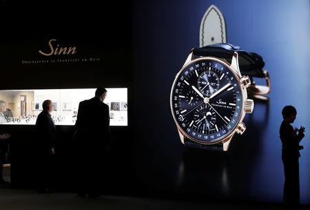 Visitors stand in front of the exhibition stand of German watch manufacturer Sinn at the Baselworld watch and jewellery fair in Basel, Switzerland March 21, 2019. REUTERS/Arnd Wiegmann