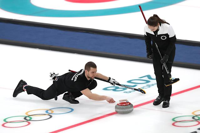 Aleksandr Krushelnitckii delivers a stone during the 2018 Olympics at PyeongChang. (Getty Images)