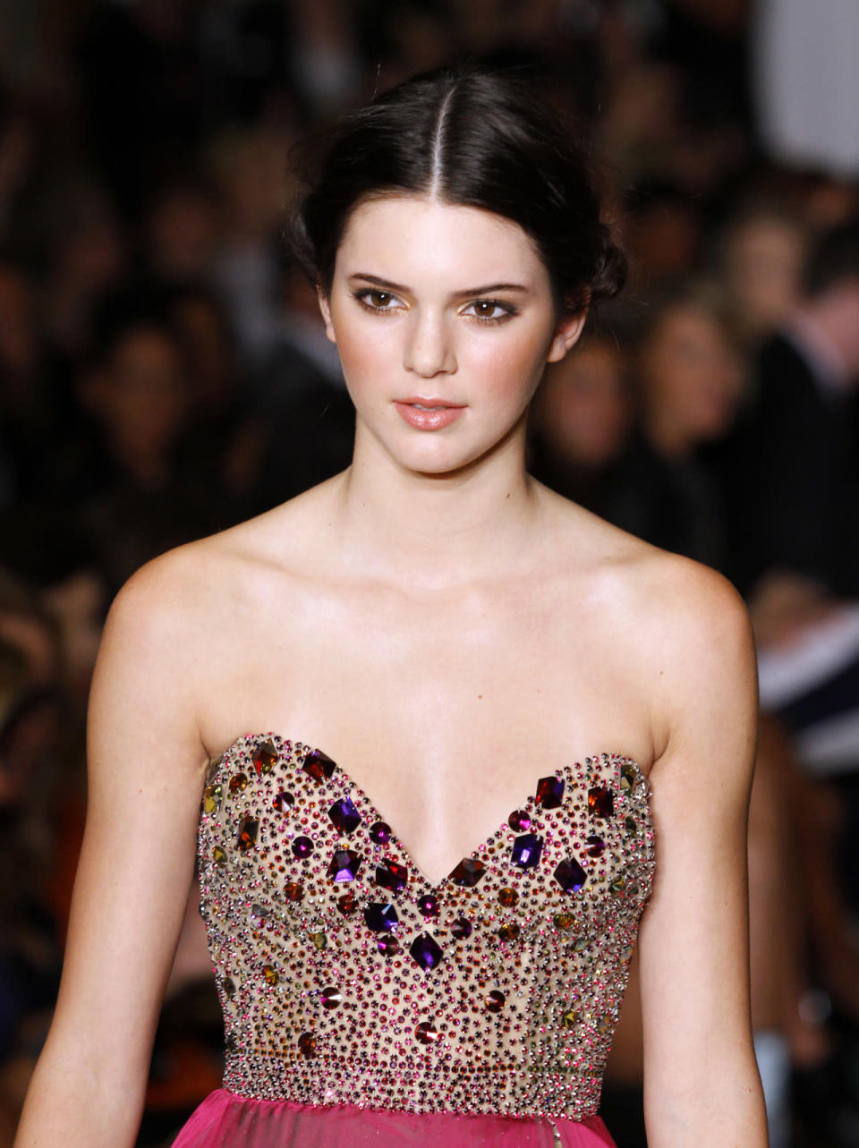 <p>Making her runway debut at the Sherri Hill Spring 2012 show in New York City, Jenner epitomized prom #goals with rosy cheeks and a simple chignon. <i>(Photo: Getty Images)</i></p>