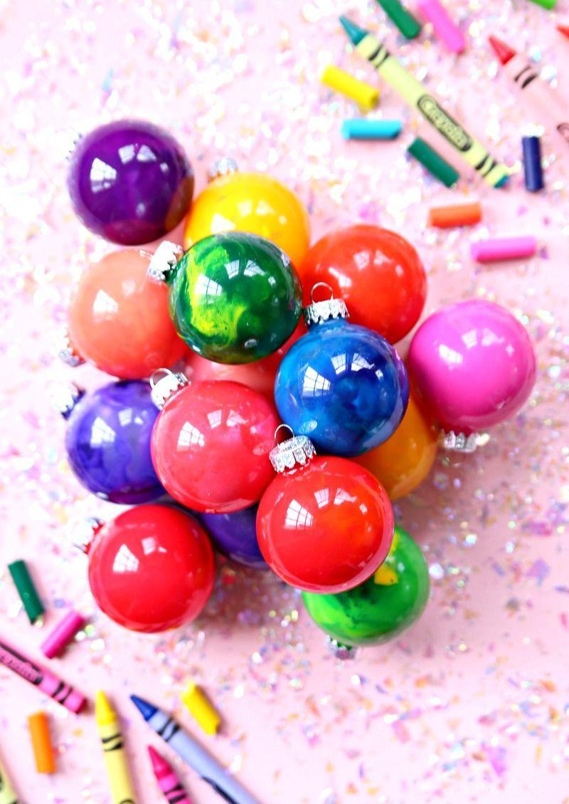 """<p>If you have bits of broken crayon littering your craft bin, turn that unusable excess into unique handmade ornaments that really shine. </p><p><em>Get the tutorial at <a href=""""https://www.happygoluckyblog.com/melted-crayon-ornaments/"""" rel=""""nofollow noopener"""" target=""""_blank"""" data-ylk=""""slk:Happy Go Lucky Blog"""" class=""""link rapid-noclick-resp"""">Happy Go Lucky Blog</a>.</em></p><p><a class=""""link rapid-noclick-resp"""" href=""""https://www.amazon.com/Crayola-Ultra-Clean-Crayons-Multicolor/dp/B07KY2HBCM?tag=syn-yahoo-20&ascsubtag=%5Bartid%7C10072.g.34443405%5Bsrc%7Cyahoo-us"""" rel=""""nofollow noopener"""" target=""""_blank"""" data-ylk=""""slk:SHOP CRAYONS"""">SHOP CRAYONS</a></p>"""