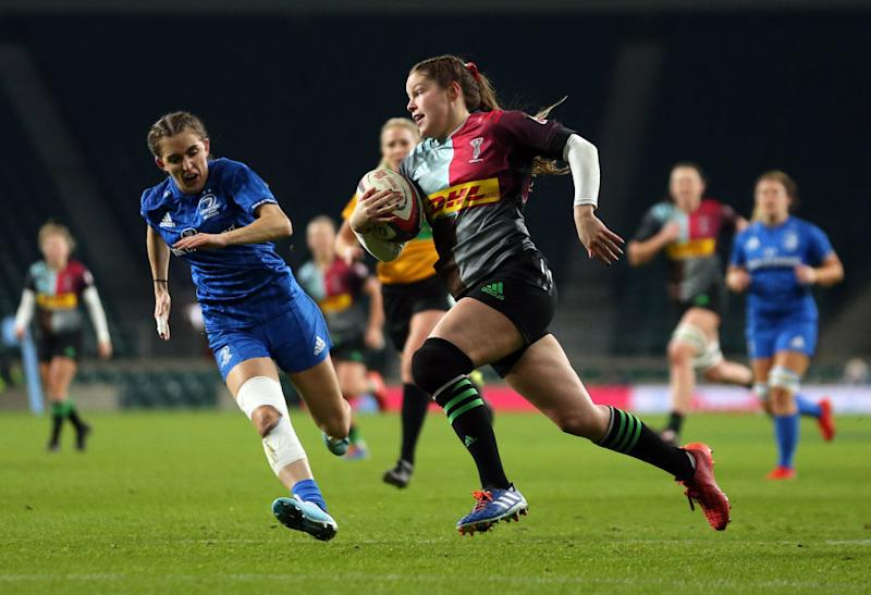 LONDON, ENGLAND - DECEMBER 28: Jess Breach of Harlequins runs in to score her side's first try / Photo by Paul Harding/Getty Images for Harlequins