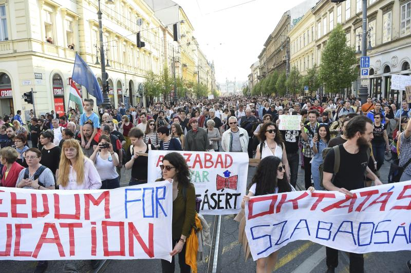 Participants walk during the rally, organized by the Freedom for Education movement, called CEU Now, Who's Next – Protest For The Free Education , in downtown Budapest, Hungary, Sunday, April 2, 2017. (Zoltan Balogh/MTI via AP)