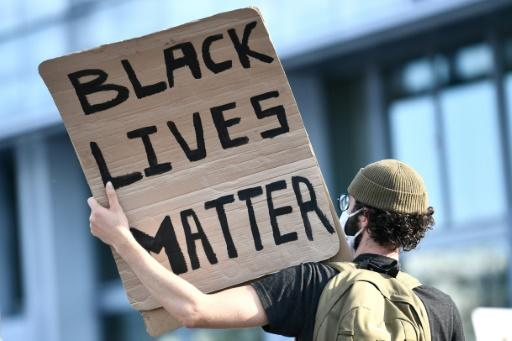 A protest holds a Black Lives Matter sign, as the Paris protest echoed the sentiments of those across the US