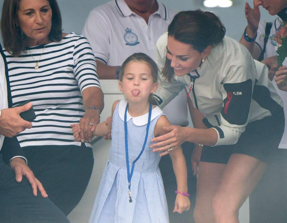 """<p>After mom <a href=""""https://www.goodhousekeeping.com/beauty/fashion/g3612/kate-middleton-best-casual-outfits/"""" rel=""""nofollow noopener"""" target=""""_blank"""" data-ylk=""""slk:Kate Middleton"""" class=""""link rapid-noclick-resp"""">Kate Middleton</a> encouraged Charlotte to wave at onlookers during the inaugural King's Cup Regatta, the little princess stuck her tongue out instead. Kate laughed at her daughter's mischievousness and threw a knowing look at the fans — a graceful move that <a href=""""https://www.instagram.com/p/B066SZIgiKR/"""" rel=""""nofollow noopener"""" target=""""_blank"""" data-ylk=""""slk:many parents applauded her for"""" class=""""link rapid-noclick-resp"""">many parents applauded her for</a> on social media.</p>"""
