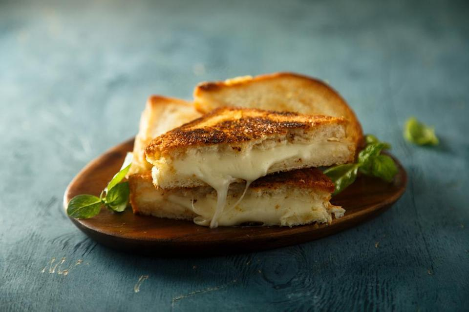 """<p>Want to learn <a href=""""https://www.thedailymeal.com/grilled-cheese-recipes?referrer=yahoo&category=beauty_food&include_utm=1&utm_medium=referral&utm_source=yahoo&utm_campaign=feed"""" rel=""""nofollow noopener"""" target=""""_blank"""" data-ylk=""""slk:how to take your grilled cheese to the next level"""" class=""""link rapid-noclick-resp"""">how to take your grilled cheese to the next level</a>? One, use mayonnaise to coat the outside of your bread (trust us). Two, use multiple cheeses. This recipe uses super melty fontina along with Monterey Jack and white cheddar.</p> <p><a href=""""https://www.thedailymeal.com/panera-copycat-grilled-cheese?referrer=yahoo&category=beauty_food&include_utm=1&utm_medium=referral&utm_source=yahoo&utm_campaign=feed"""" rel=""""nofollow noopener"""" target=""""_blank"""" data-ylk=""""slk:For the Fontina Grilled Cheese recipe, click here."""" class=""""link rapid-noclick-resp"""">For the Fontina Grilled Cheese recipe, click here.</a></p>"""