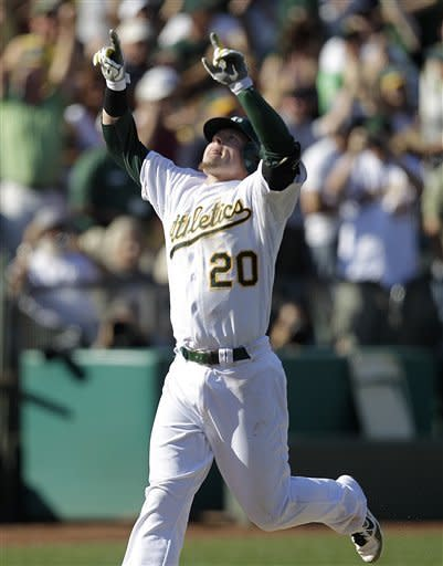 Oakland Athletics' Josh Donaldson celebrates after hitting a two-run home run off Seattle Mariners' Tom Wilhelmsen in the ninth inning of a baseball game Saturday, Sept. 29, 2012, in Oakland, Calif. The Athletics won 7-4 in 10 innings. (AP Photo/Ben Margot)