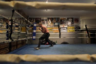 Leo Larsen wears a mask while shadow boxing in the ring before instructing a class at a Hit Fit SF gym amid the coronavirus outbreak in San Francisco, Tuesday, Nov. 24, 2020. (AP Photo/Jeff Chiu)