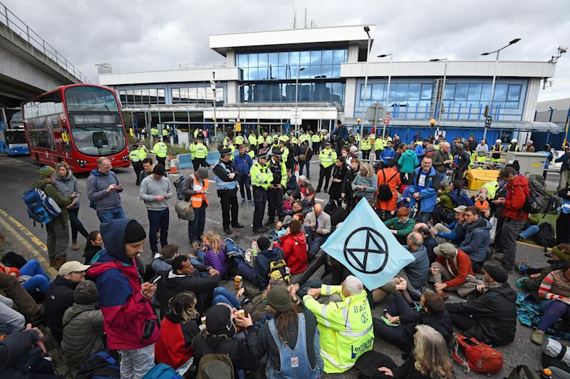 Protesters stage a 'Hong Kong style' blockage of the exit from the train station to City Airport, London, during an Extinction Rebellion climate change protest.