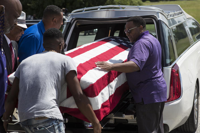 The body of New Orleans Police detective Everett Briscoe is placed into a hearse before it is escorted from the Respect for Life Funeral Home for the journey back to New Orleans, Tuesday, Aug. 24, 2021, in Houston. Briscoe was shot and killed Saturday, Aug. 21, at Grotto Ristorante during an attempted robbery while visiting Houston with his fraternity. (Brett Coomer/Houston Chronicle via AP)